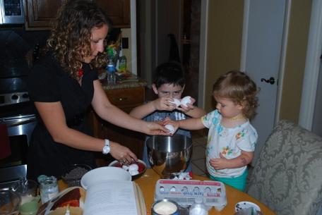kids helping to bake a cake