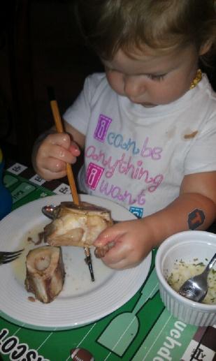 Emma eating bone marrow