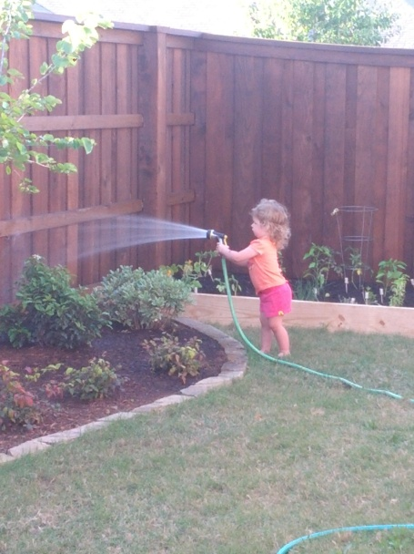 Emma watering the plants