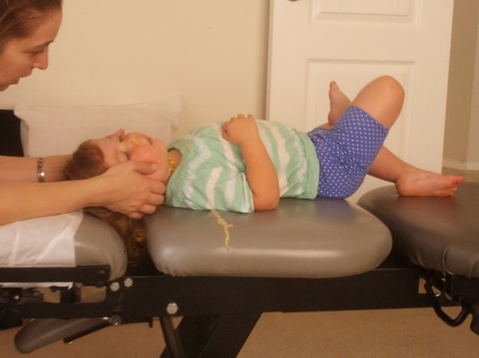 Emma getting adjusted at the chiropractor